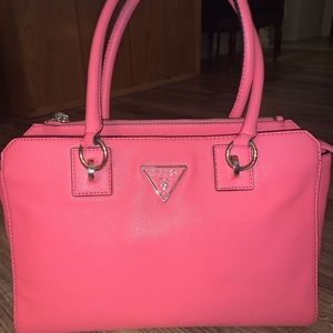 Brand new with tag guess bag.